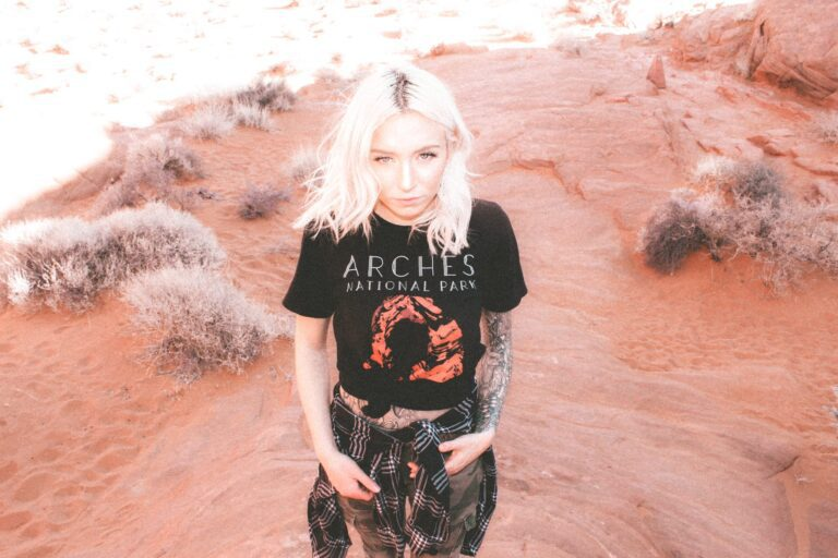 one female in a valley with an Arches National Park shirt