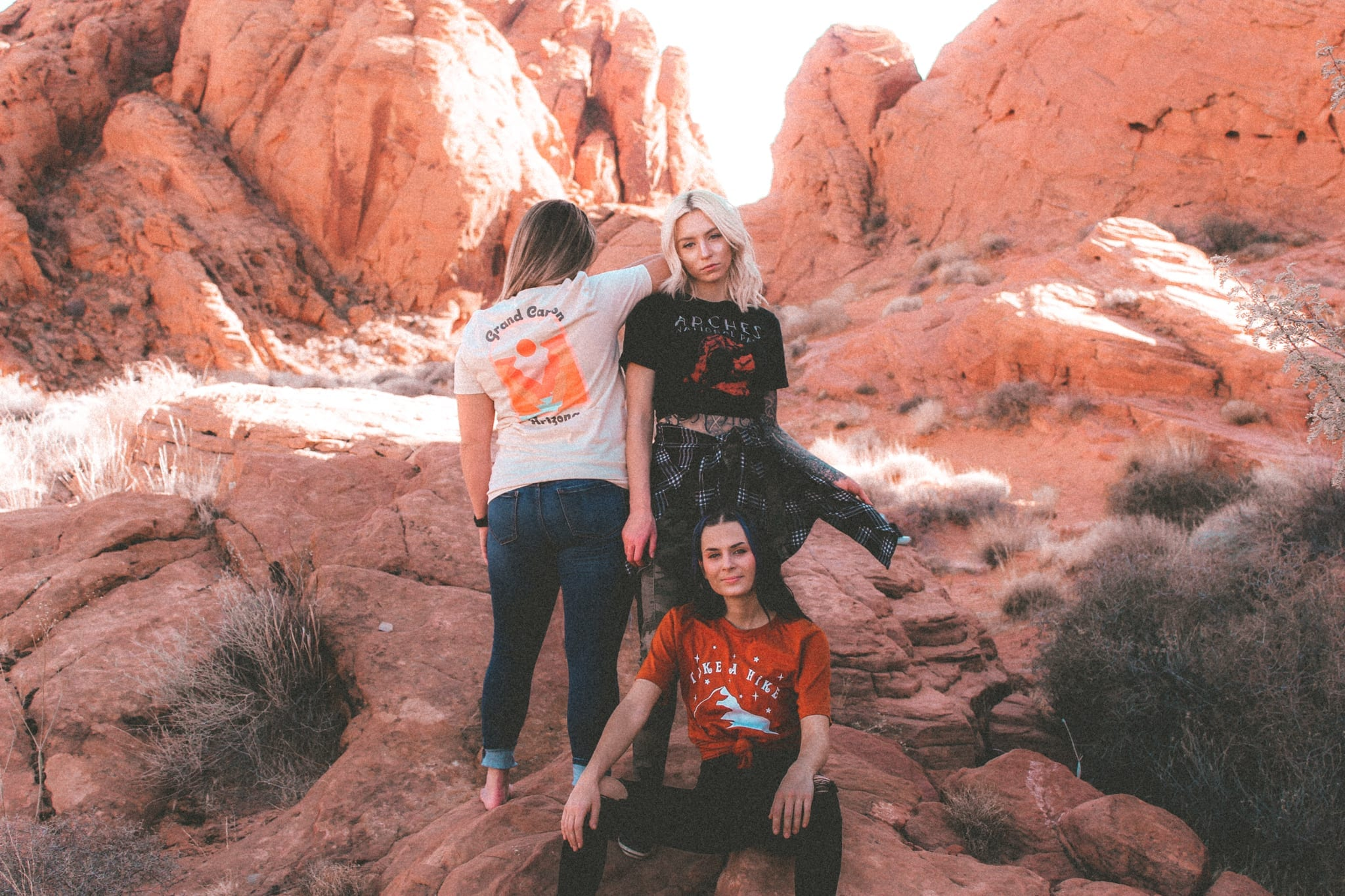 three women in a valley of red rocks