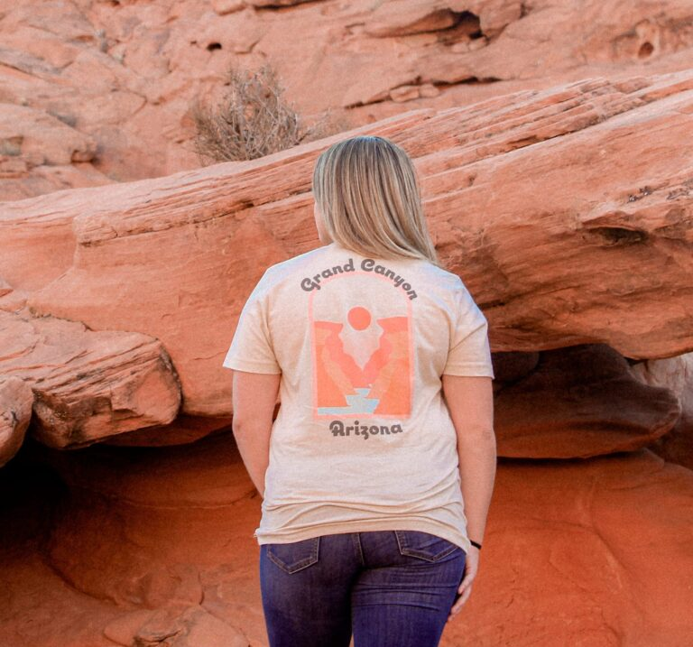 woman looking at a series of red rocks in a grand canyon t-shirt