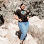 female in blue jeans and a black yellowstone national park t-shirt