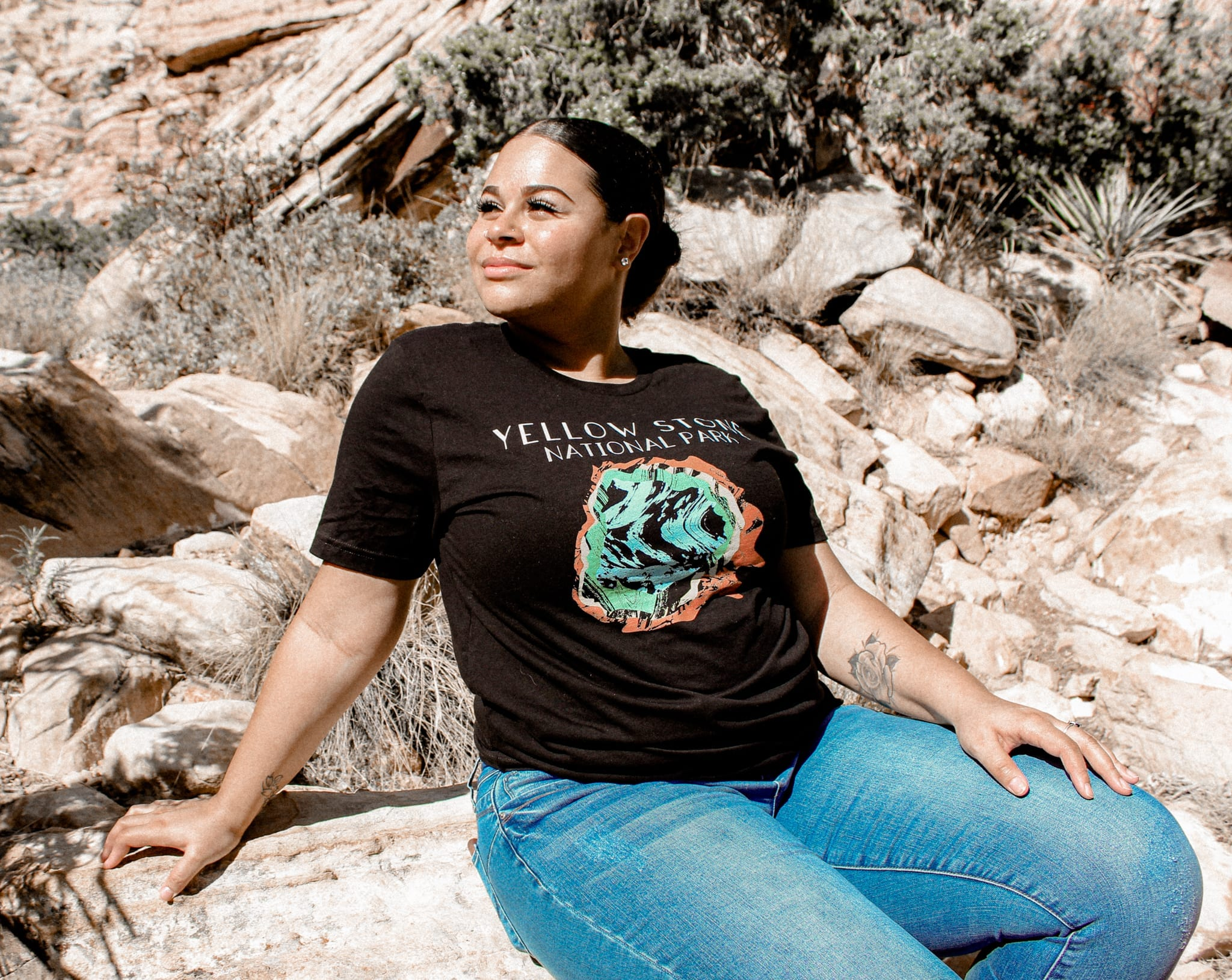 Woman in the mountains, with yellowstone t-shirt