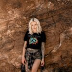 female in the mountains with a black yellowstone national park shirt