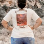 Woman in the mountains, with Canyonlands shirt